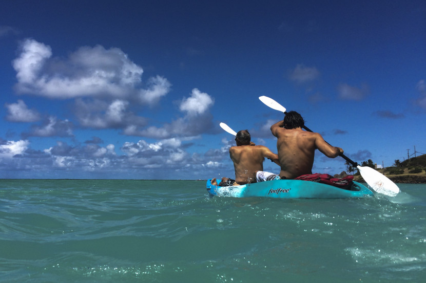 Grandfather & Grandson Paddling out at Kailua Beach Park, Oahu, Hi