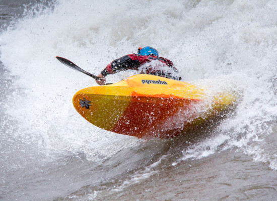 Surfing G-Wave. North Fork American River. Paddler: Robby Hogg